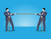 Fight for market share business concept. Two businessmen in suits standing against each other, pulling a rope. Every businessman is trying to overcome his Royalty Free Stock Photos