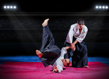 Fight between martial arts fighters at sports hall Royalty Free Stock Image