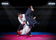 Fight between martial arts fighters at sports hall Stock Image