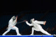Fight in motion on championship of world in fencing Royalty Free Stock Photos