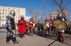 Fight one by one. RUSSIA, MOSCOW - MARCH 14: Unidentified knights fight on tournament on history reenactment of the Medieval maneuvers in Moscow, 14 March, 2015 stock images