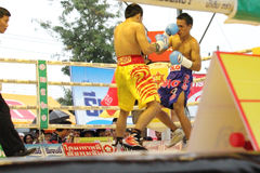 Fight for PABA Super Flyweight Champion. SURAT THANI, THAILAND - DECEMBER 14 : Norasing Kokietgym and Michael Escobia fight for PABA Super Flyweight Champion on royalty free stock photography
