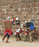 Fight between the pedestrian knights in a heavy ar Royalty Free Stock Image