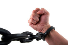 Fight the Power. Male Hand with Fist Chained to Linked Cuffs Stock Photo
