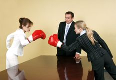 Fight for promotion. Metaphoric illustration of the corporate fight between employees in the race to attend a higher position within the company Stock Photo