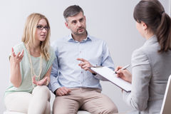 Fight on psychotherapy. Young marriage and fight during couple psychotherapy royalty free stock images