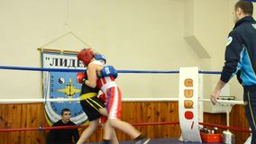 The fight in the ring two boys. MARIUPOL, UKRAINE - December, 2015 : Boxing tournament among juniors. The fight in the ring two boys. Video was obtained in a stock footage