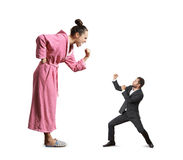 Fight between screaming woman and man. Fight between screaming angry women and small mad man. isolated on white background royalty free stock image