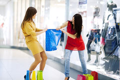 Fight for shopping bag stock image