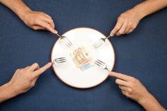 Fight to eating euros Stock Photo