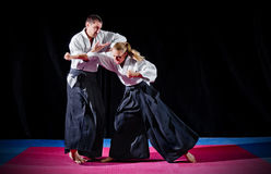 Fight between two aikido fighters Royalty Free Stock Image