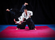 Fight between two aikido fighters Royalty Free Stock Photos