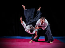Fight between two aikido fighters Royalty Free Stock Photo