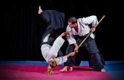 Fight between two aikido fighters Stock Photos