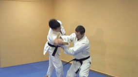 Fight between two aikido fighters. stock footage