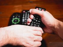Fight for the remote control. Fight between two hands for remote control. First person point of view. Concept royalty free stock images