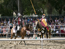 Fight between two horse back knights Stock Photography