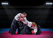 Fight between two martial arts fighters Royalty Free Stock Image