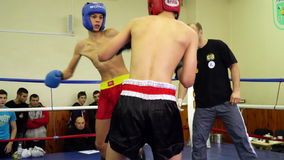 Fight of two teenagers in the ring. Mariupol, Ukraine - November 26, 2016: The city championship in kickboxing Fight of two teenagers in the ring .Video was stock video footage