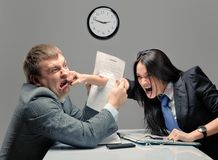 Fight. Two young caucasian office worker starting to fight Royalty Free Stock Photos