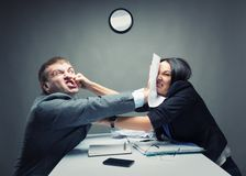 Fight. Two young caucasian office worker starting to fight Royalty Free Stock Images