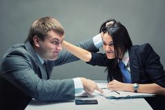Fight. Two young caucasian office worker starting to fight Stock Photo