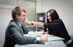 Fight. Two young caucasian office worker starting to fight Royalty Free Stock Photo