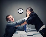 Fight. Two young caucasian office worker starting to fight Stock Image