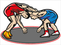 Fight, wrestling. This file represents two muscular young fighters in an encounter with a tracksuit red and another one blue. Everything is grouped and divided Stock Photo