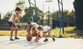 Fight for yourself. Family playing basketball stock photos