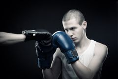 Fighter. Boxer fighting with another one over dark background Stock Photography