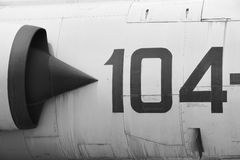 Fighter aircraft fuselage metallic detail with number 104 Stock Photo