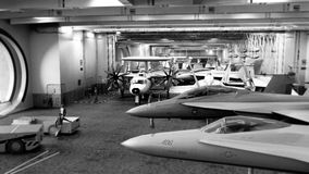 Fighter aircraft on the inner deck of an aircraft carrier 3d ren. Der Stock Images