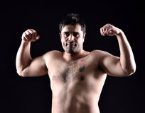 Fighter boxer. Standing staring strong on black background. Young masculine caucasian male athlete in his 20s Stock Images