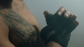 Fighter boxing bandage. Boxer strikes. Closeup of fighter preparing boxing match stock video footage