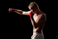 Fighter boxing over black background Stock Photography