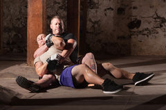 Fighter In Choke Hold. Mixed martial artist with opponent in submission choke hold stock photo