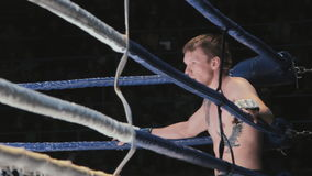 Fighter in the corner of the ring rests stock video footage