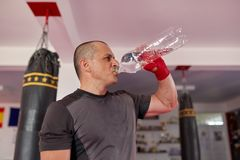 Fighter drinking water stock photos