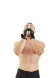 Fighter with fight gloves and bandage around his hands pray for Stock Image