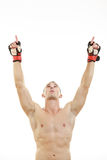 Fighter with fight gloves and bandage around his hands pray for Royalty Free Stock Photo