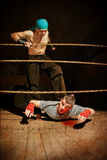 The fighter finishes off the opponent Royalty Free Stock Images