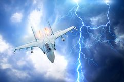 Fighter flies afterburner in the clouds flash of lightning.  royalty free stock photography