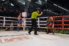Muaythai World Championships. A fighter is given the referee's count while competing in a match in the WMF Muaythai World Championships at the Thai National Royalty Free Stock Image