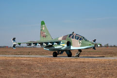 The fighter goes to the runway. Training and combat aircraft Su-25UB, Kushchevskaya, Russia, October 3, 2015 royalty free stock photography