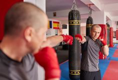 Shadow boxing in the mirror stock image