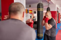 Shadow boxing in the mirror royalty free stock photo