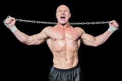 Fighter holding chain with arms raised Stock Photo