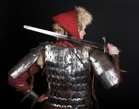 Fighter is holding a sword Royalty Free Stock Images