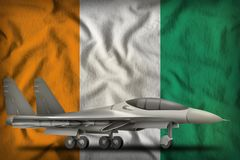 Fighter, interceptor on the Cote d Ivoire state flag background. 3d Illustration. Fighter, interceptor on the Cote d Ivoire flag background. 3d Illustration Royalty Free Stock Photography